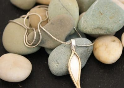 Silver pendant with gold outline 32