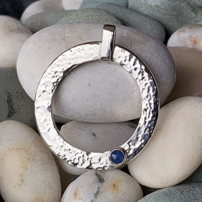 Hand Made Jewellery - Hammered effect pendant with sapphire